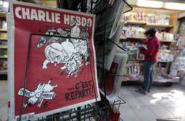 """The front page of the new issue of satirical French weekly Charlie Hebdo entitled """"C'est Reparti"""" (""""Here we go again""""),  is displayed at a kiosk in Nice, Feb. 25, 2015."""