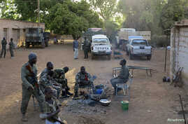 Soldiers rest at the Malian military base  in Diabaly, which just ten weeks ago was under control of Islamist rebels, 400 km from Bamako, March 15, 2013.