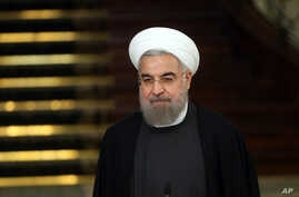 FILE - Iranian President Hassan Rouhani attends a joint press conference with his Chinese counterpart Xi Jinping after their meeting at the Saadabad Palace in Tehran, Iran, Jan. 23, 2016.