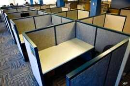 "A typical cubicle array, or ""cubicle farm."""