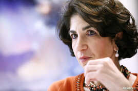 Fabiola Gianotti, scientist at the European Organization for Nuclear Research (CERN), gestures during an interview with Reuters in Meyrin near Geneva, December 15, 2014.