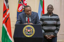 Kenya's President Uhuru Kenyatta flanked by his deputy, William Ruto, addresses the nation at State House in Nairobi, Kenya, Sept. 1, 2017.