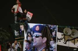 Opponents of ousted President Mohammed Morsi with poster of General Abdul Fatah al-Sisi, Cairo, July 19, 2013.