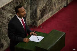 Abiye Ahmed, the newly elected chair of the Ethiopian Peoples' Revolutionary Democratic Front  addresses Ethiopian lawmakers after he was sworn in as the country's Prime Minister, April 2, 2018.