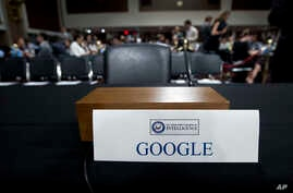 An empty chair reserved for Google's parent Alphabet, which refused to send its top executive, is seen as Facebook COO Sheryl Sandberg accompanied by Twitter CEO Jack Dorsey testify before the Senate Intelligence Committee hearing on 'Foreign Influen
