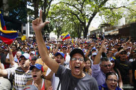 Anti-government protesters shout during a protest against Nicolas Maduro's government in Caracas, March 3, 2014.