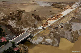An aerial view shows a collapsed bridge on the outskirts of Acapulco September 20, 2013.