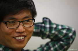 Shin Dong-hyuk, a North Korean defector who has given the U.N. panel harrowing accounts of his life and escape from a prison camp, smiles during an interview with Reuters in Seoul, February 10, 2014.