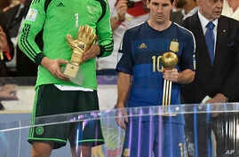 Germany's goalkeeper Manuel Neuer winner of the golden glove award for best goalkeeper stands alongside golden ball winner Argentina's Lionel Messi after the World Cup final soccer match between Germany and Argentina in Rio de Janeiro, Brazil, July 1