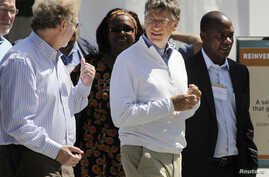 "FILE - Bill Gates (R) and former Microsoft chief technology officer and co-founder of Intellectual Ventures Nathan Myhrvold (L) speak while reviewing the displays at the ""Reinvent the Toilet Fair"" competition at the Bill and Melinda Gates Foundation"