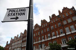 A polling station sign is seen ahead of the forthcoming general election, in London, June 6, 2017.