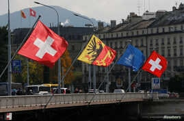 Swiss and Canton of Geneva flags are seen flying on the Mont-Blanc bridge in Geneva, Switzerland, Oct. 11, 2016. Swiss lawmakers plan to submit to government a new broad EU treaty that would replace patchwork of bilateral deals now under strain from
