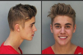 These police booking mugs made available by the Miami Dade County Corrections Department show pop star Justin Bieber, Thursday, Jan. 23, 2014.
