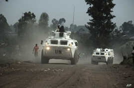 FILE - United Nations armored personnel carriers are seen north of the provincial capital of Goma, eastern Democratic Republic of Congo, Aug. 30, 2013. The U.N. appears to have lost two of its investigators who went missing in central Congo March 12,