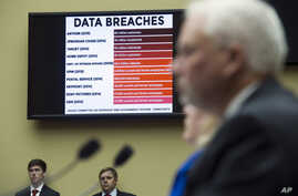 FILE - A chart of data breaches is shown on Capitol Hill in Washington, June 16, 2015.