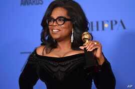 Oprah Winfrey poses in the press room with the Cecil B. DeMille Award at the 75th annual Golden Globe Awards at the Beverly Hilton Hotel on Jan. 7, 2018, in Beverly Hills, Calif.