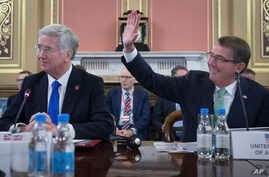 Britain's Defense Secretary Sir Michael Fallon, left, and U.S. Secretary of Defense Ash Carter are pictured at the Foreign Office in London during a summit with defense ministers from the coalition of countries fighting Islamic State forces, Dec. 15,