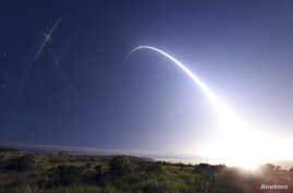 FILE - An unarmed Minuteman III intercontinental ballistic missile launches during an operational test from Vandenberg Air Force Base February 25, 2016.