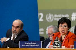 Margaret Chan, WHO director general, is flanked by FAO director general Jose Graziano da Silva as she speaks during the opening session of FAO's second International Conference on Nutrition, in Rome, Nov. 19, 2014.