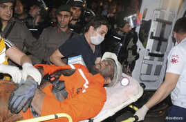 An injured miner is carried to an ambulance in Soma, south of Istanbul, May 13, 2014.