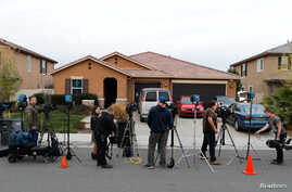 Members of the news media stand outside the home of David Allen Turpin and Louise Ann Turpin in Perris, California, Jan. 15, 2018.