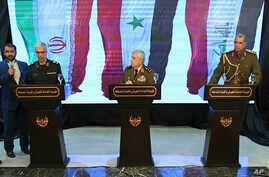 In this photo released by the Syrian official news agency SANA, Iran's Chief of Staff of Armed Forces, Maj. Gen. Mohammad Hossein Bagheri, left, speaks during a press conference with Syria's defense minister Gen. Ali Ayoub, center, and Iraqi army com