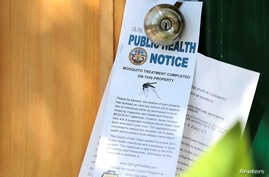 Notices given to homeowners as San Diego County officials hand spray a two block area to help prevent the mosquito-borne transmission of the Zika virus in San Diego, California, U.S. Aug. 19, 2016.