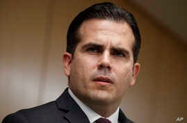 FILE - In this Nov. 13, 2017, photo, Puerto Rico Gov. Ricardo Rossello speaks during a news conference, in Washington. Rosello said on Jan. 22, 2018, that he is privatizing the island's government-owned power company following decades of mismanagem...