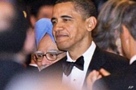 President Barack Obama and his Indian counterpart Manmohan Singh arrive for the first official State Dinner of Obama's administration at the White House, 24 Nov 2009