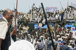 Sudan's President Omar Al Bashir (L) waves to supporters during a visit to Osaef town in Sudan's Red Sea state, June 20, 2011