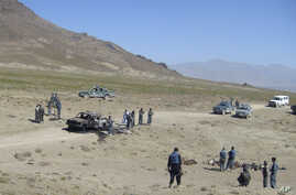 FILE- The scene of an attack is seen in Afghanistan's Paktia province, June 24, 2008.