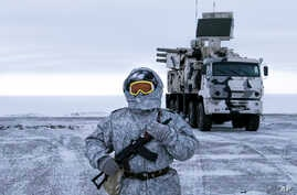 In this photo taken on April 3, 2019, a Russian solder stands guard near a  Pansyr-S1 air defense system on the Kotelny Island, part of the New Siberian Islands archipelago located between the Laptev Sea and the East Siberian Sea, Russia.