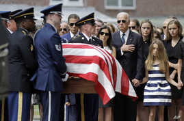 Vice President Joe Biden, accompanied by his family, watches an honor guard carry a casket containing the remains of his son Beau Biden into a funeral service at St. Anthony of Padua Roman Catholic Church in Wilmington, Del., June 6, 2015.