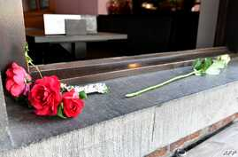 Flowers are layed at the cafe Les Augustins, just after the security perimetre was lifted, at the scene of a deadly shooting on the boulevard d'Avroy in the eastern Belgian city of Liege, on May 29, 2018.