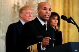 FILE - Surgeon General Jerome Adams speaks at the White House in Washington, Feb. 13, 2018. Adams is expected to speak about a public health advisory regarding an opioid overdose antedote Thursday at the National Rx Drug Abuse & Heroin Summit in Atla