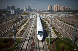 a CRH high-speed train leaves the Beijing South Station for Shanghai during a test run on the Beijing-Shanghai high-speed railway in Beijing, China, (File photo).