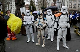 People dressed as Stars Wars stormtroopers and Big Bird wait to move off at the the start of the annual New Year's Day street parade in London, Jan. 1, 2018. The New Year's Day parade has become a widely anticipated international event.(