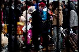 Passengers at the Beijing railway station Tuesday, Feb. 5, 2013, are among millions returning home for the the Chinese Lunar New Year which starts on Feb. 10.