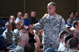 Lt. Gen. Jay Silveria, superintendent of the U.S. Air Force Academy, discusses his goals and priorities to an audience of Total Force Airmen at the United States Air Force Academy in Colorado, U.S. on Aug.17, 2017.