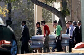 Pall bearers carry the casket of Scott Beigel after his funeral in Boca Raton, Fla., Sunday, Feb. 18, 2018.
