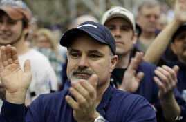 On Feb. 25, 2011, Boeing Co. workers applaud during a rally at Boeing's 767 assembly plant in Everett, Wash. The rally was held to celebrate Boeing winning a $35 billion Air Force contract.