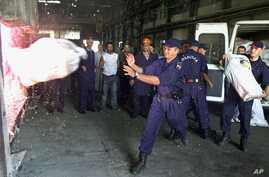 FILE - Montenegrin policemen incinerating various narcotics seized in drug smuggling busts across the Balkan republic, at the huge furnaces inside an aluminium plant in the Montenegrin capital, Podgorica.