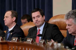 House Intelligence Committee Chairman Rep. Devin Nunes, R-Calif., and the committee's ranking member Rep. Adam Schiff, D-Calif. (left) listen on Capitol Hill in Washington, March 20, 2017, during the committee's hearing on allegations of Russian inte
