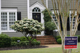 FILE - A campaign sign for Republican congressional candidate Dave Brat is posted in front of his home in Glen Allen, Virginia, June 12, 2014. Brat defeated House Majority Leader Eric Cantor in that year's Republican primary.