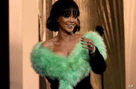 """FILE - Rihanna arrives on stage to perform """"Love On The Brain"""" at the Billboard Music Awards in Las Vegas."""