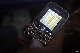 A voter in Kano looked for election figures on his smartphone.