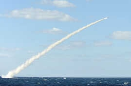 In this undated photo released by the South Korean Defense Ministry on February 14, 2013, a South Korean sea-to-land cruise missile is fired from a submarine during a drill at an undisclosed location in South Korea.