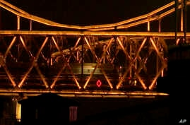 China North KoreaIn this image taken from video footage, a train similar to ones seen during previous visits to China by North Korean leader Kim Jong Un crosses the Friendship Bridge from North Korea into China as seen from Dandong in northeastern Ch