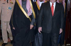 A handout photo released by the Press Information Department (PID) shows Pakistani Prime Minister Muhammad Nawaz Sharif (R) welcoming Saudi Crown Prince Salman bin Abdul Aziz Al- Saud upon the latter's arrival at the Prime Minister's House in Islamab
