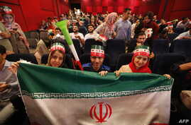 Iranians watch the World Cup Group B soccer match between Morocco and Iran at Azadi cinema in Tehran, June 15, 2018.
